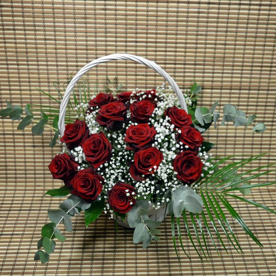 Basket arrangement with 15 red roses